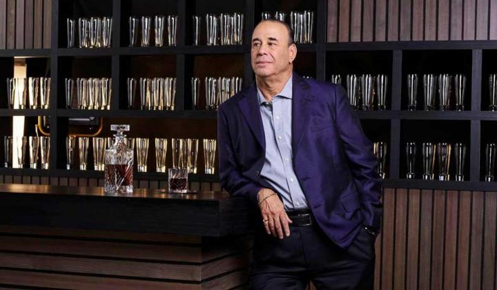 Jon Taffer leaning against the bar
