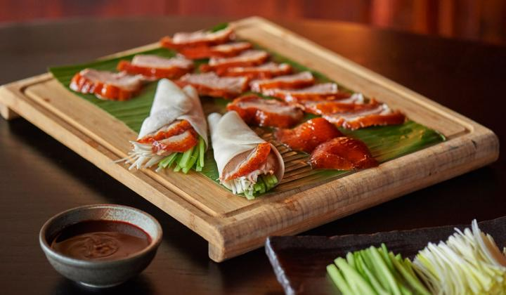 Hutong's Roasted Peking Duck is delicately carved at the table.