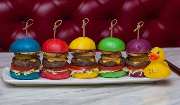 Rainbow sliders with a rubber duck at Sugar Factory restaurant.