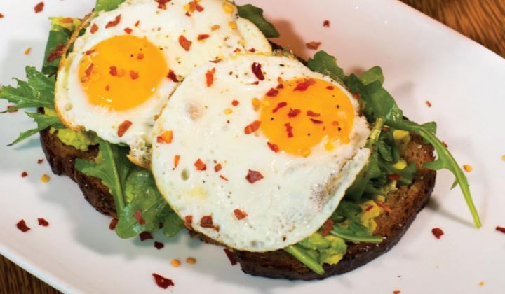 In addition to its Salted Caramel Chicken & waffles, HopCat excels in brunch staples like avocado toast topped with eggs and Egg in the hole sandwiches.