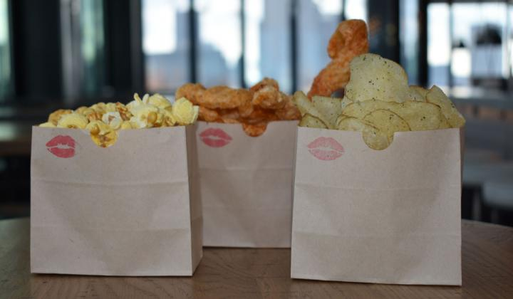 Snacks in three bags from Cameron Mitchell Restaurants.