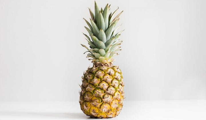 Pineapple on white surface.