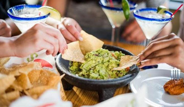 Customers eat guacamole at Chili's restaurant.