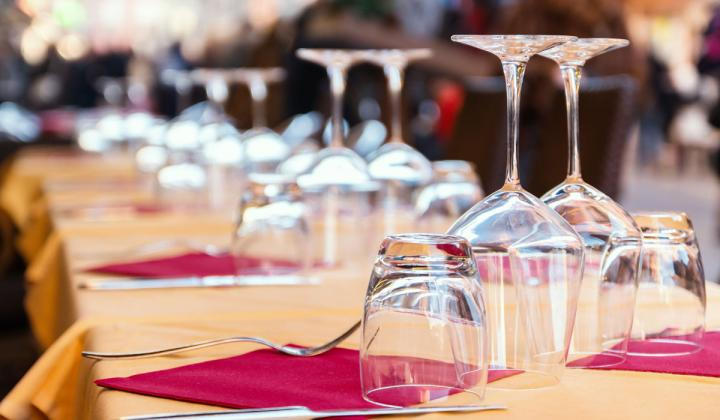 Clear glasses in a restaurant in the city street.