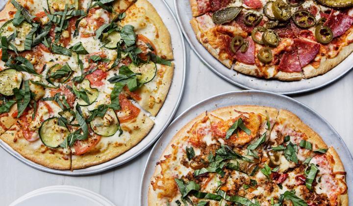 Pi Pizzeria pizzas on display.