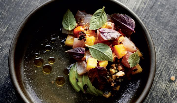 The Almaco Ceviche features longfin yellowtail, pickled mangos, avocados, and peanuts.