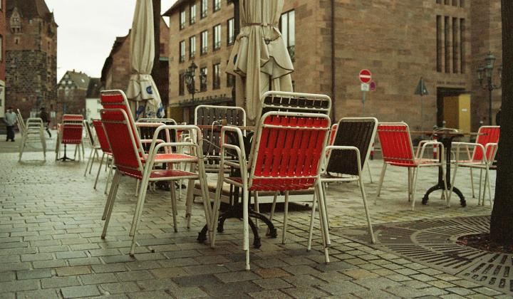 Tables outside an empty restaurant.