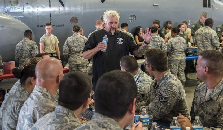 Guy Fieri chatting with members of the Joint Base San Antonio Airmen in 2017.