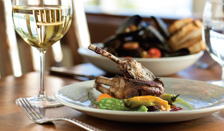 Lone Eagle Grille's menu features a saffron-braised Lamb Shank, sourced from Niman Ranch.