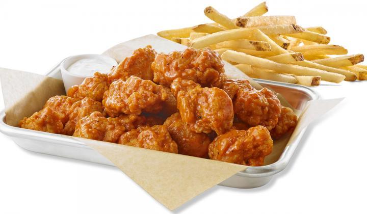 Buffalo Wild Wings boneless wings and fries.