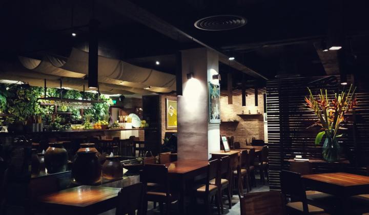 The darkly lit interior of an empty restaurant.