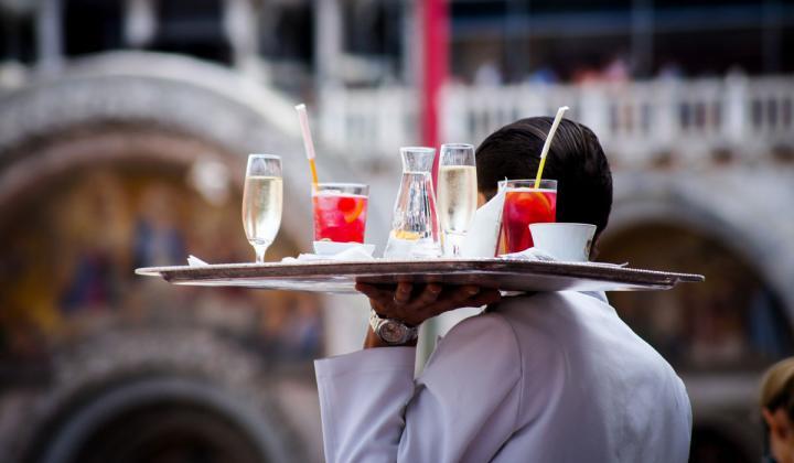 Waiter serving beverages.