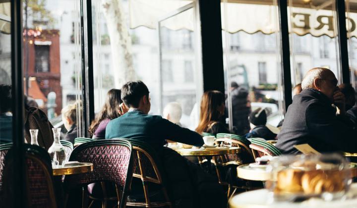 Guests dine inside a restaurant.