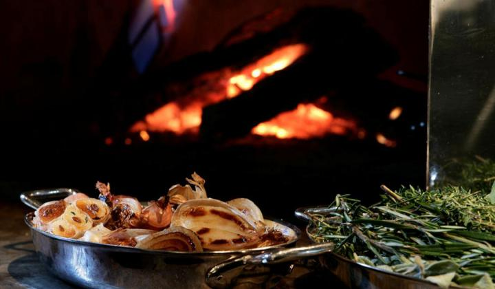 Blue Duck Tavern dish in front of a fire.