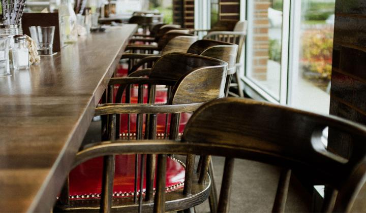 Chairs against a bar at an empty restaurant.