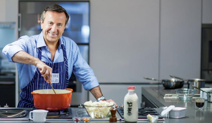 Daniel Boulud cooking in the kitchen.