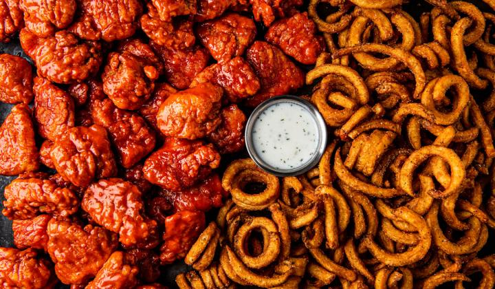 Wings and curly fries.