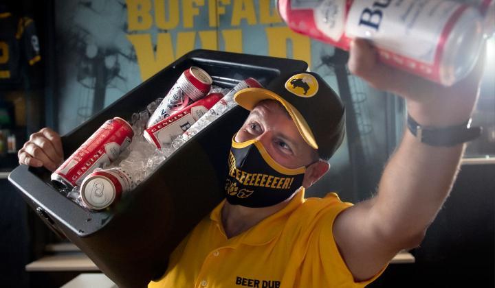 Buffalo Wild Wings' vendor carrying beer.