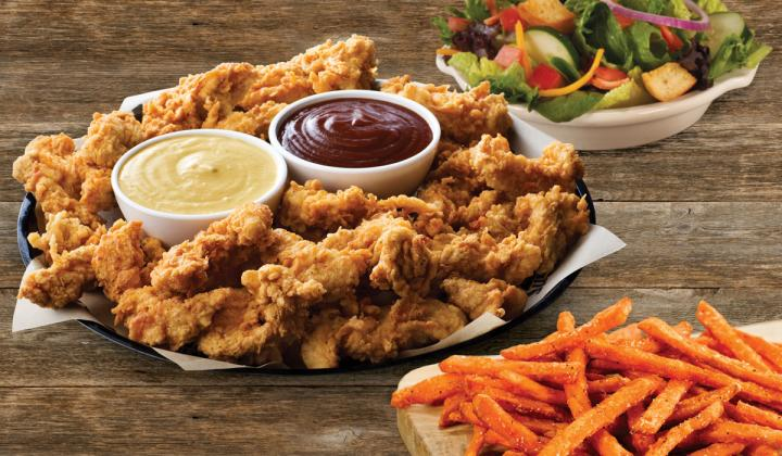 Logan's Roadhouse family platter of chicken tenders and sides.
