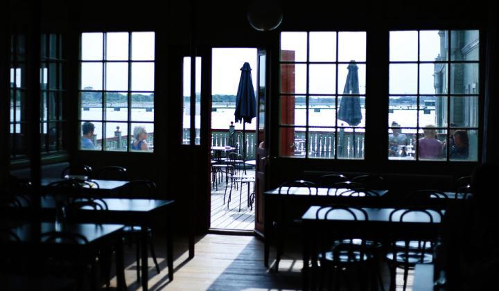 Darkly lit interior of a restaurant.