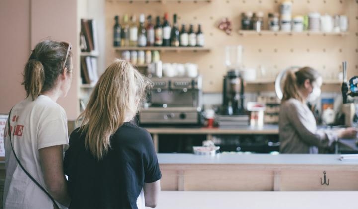 Two customers in a coffee shop.