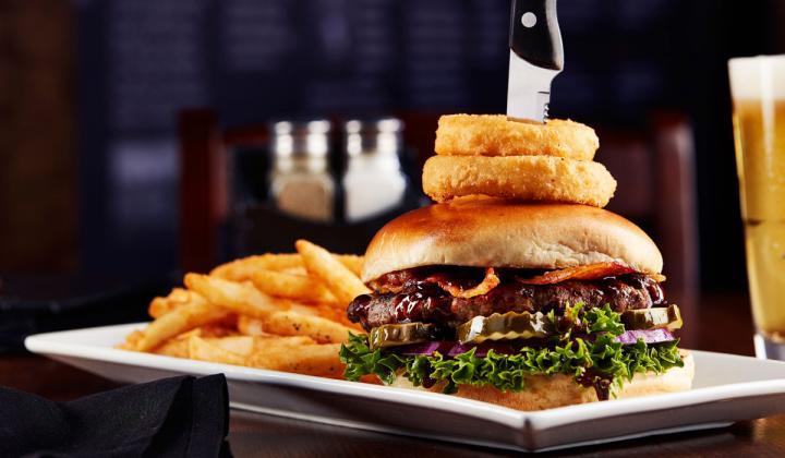 Big Whiskey's burger with a knife through it.