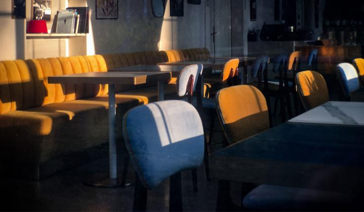 Inside an empty restaurant with colorful booths.