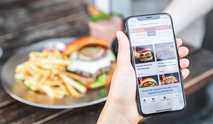 Guest orders food on a mobile device from Eureka.