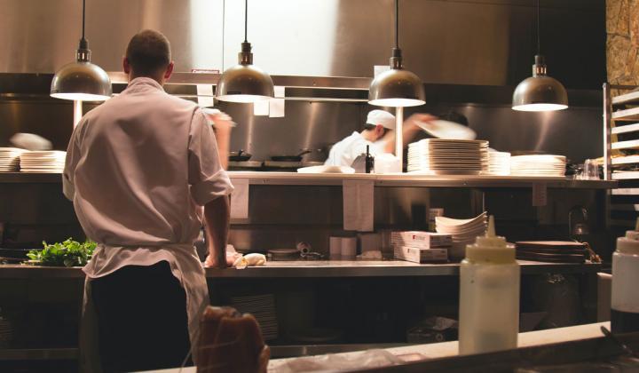 Restaurant employees in the kitchen.