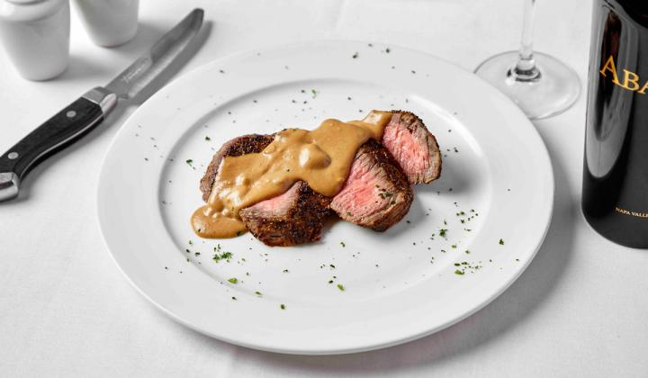 Steak on a white plate at III Forks restaurant.