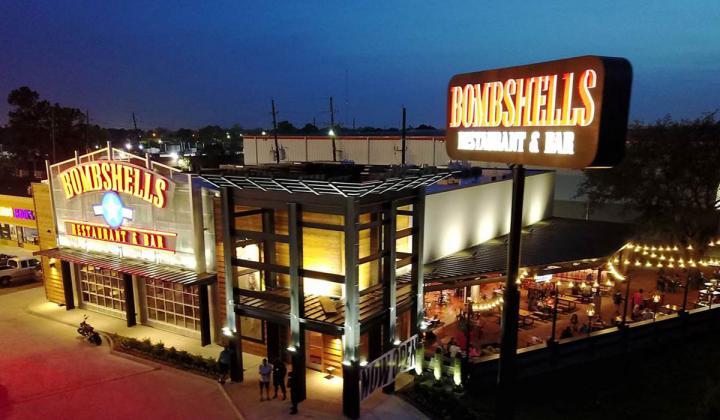 Bombshells Restaurant & Bar seen at night.