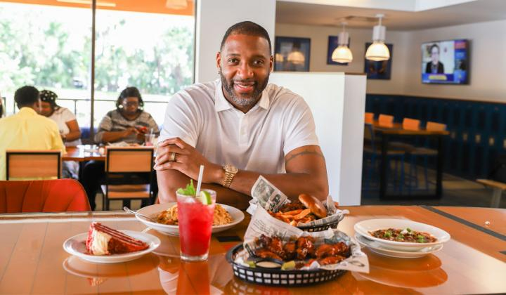 Tracy McGrady sits at a table.