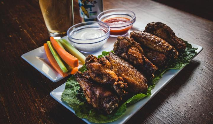 Chicken wings and beer with sauces.