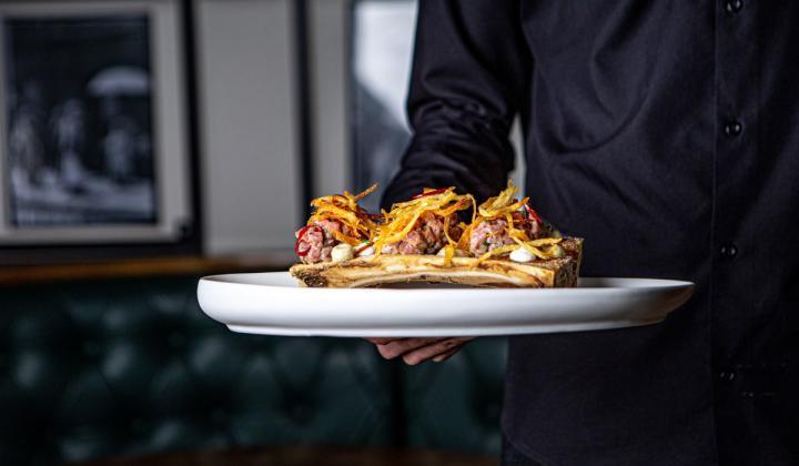 Waiter holding food.