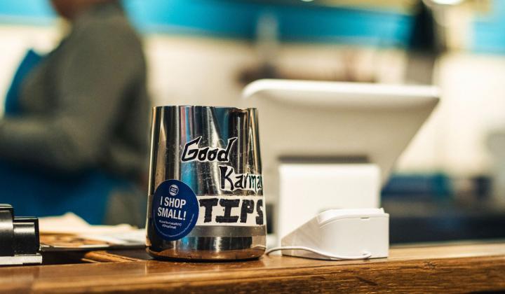 Tip jar on a table.