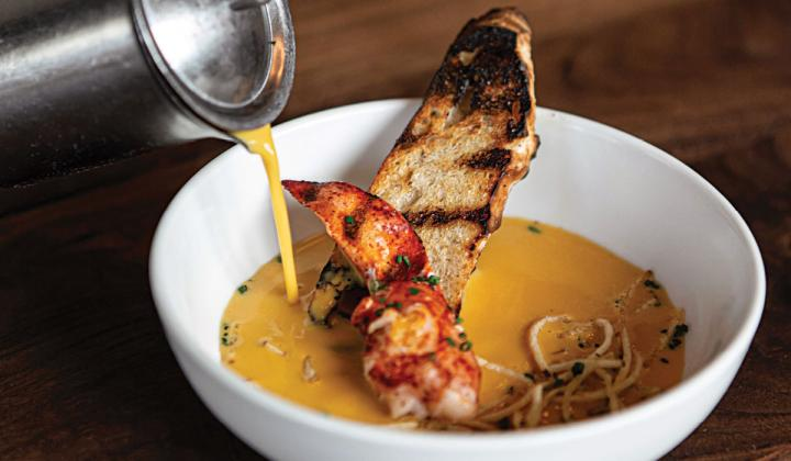 THE LOBSTER BISQUE WITH BAGUETTE IS ONE OF MANY FRESH, SEASONAL OFFERINGS AT BOROUGH IN MINNEAPOLIS.