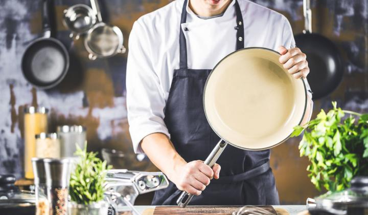 Chef holding a pan.