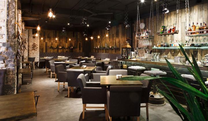 Interior of cozy restaurant, loft style.