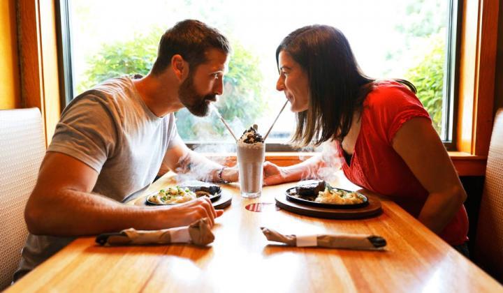 Walker Hayes and his wife Laney sipping an Applebee's milkshake.