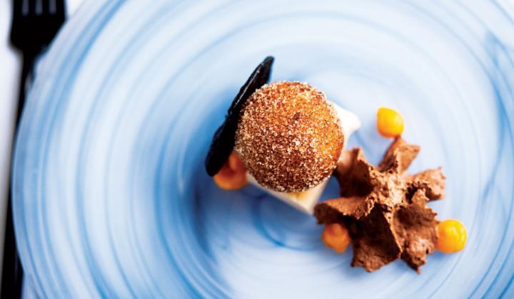 Xiquet's Xocolate dessert features a pumpkin doughnut atop an almond cloud, with chocolate mousse.