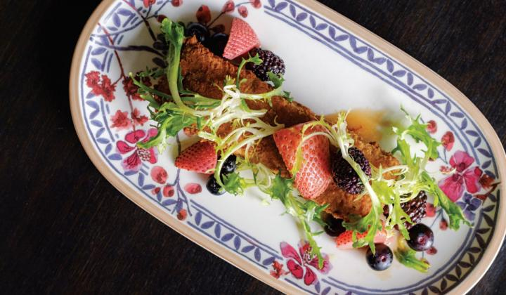 Southern flavors take a fine-dining turn in dishes like the frisse and Duck Fat vinaigrette salad at Henley.
