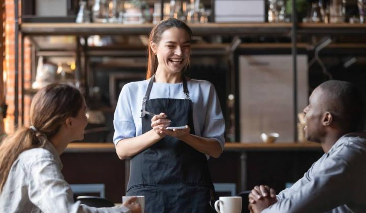 Stock photo of waiter and customers.