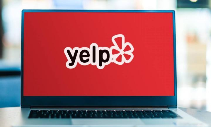 Yelp logo on laptop.