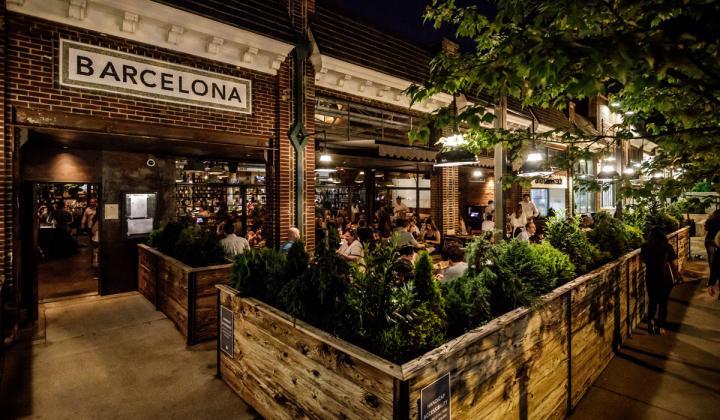 Barcelona Wine Bar exterior patio at night.