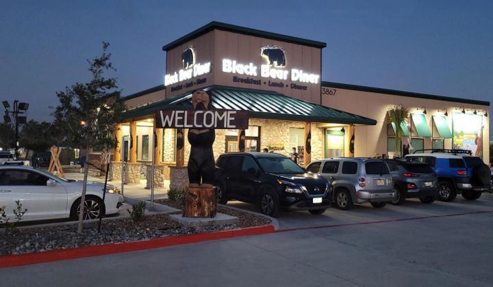 Black Bear Diner exterior of restaurant at night.
