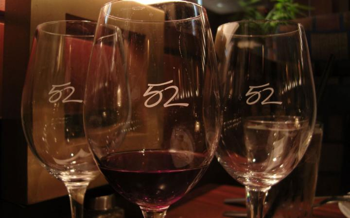Wine glasses at Seasons 52, an upscale Darden restaurant.