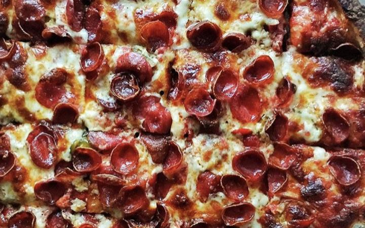 Close-up of pizza with pepperoni topping