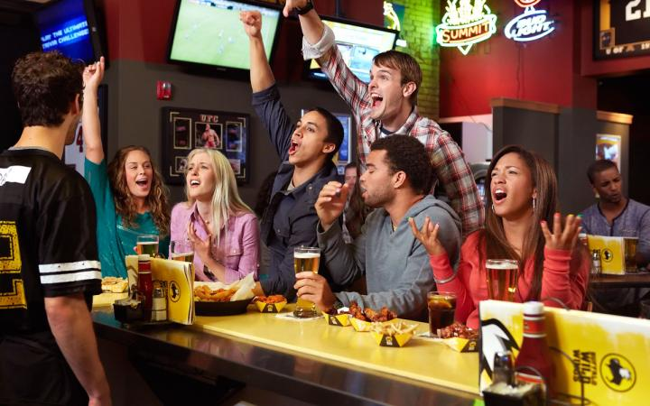 Fans gather at Buffalo Wild Wings to watch sports and cheer, while eating wings and dining out.