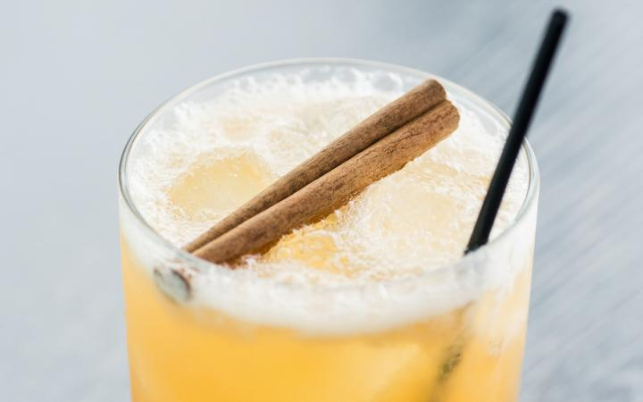 Margarita glass with straw and cinnamon stick