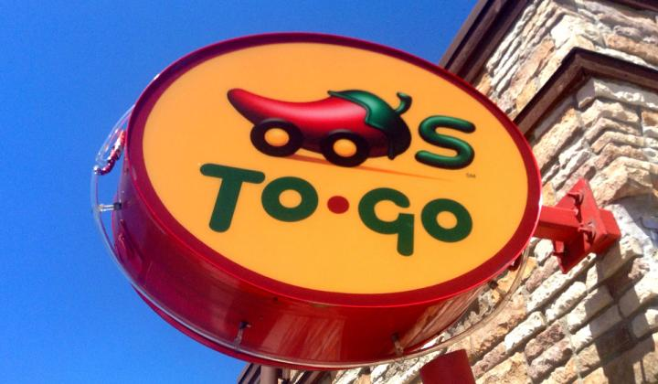 Chili's to-go sign outside a restaurant.